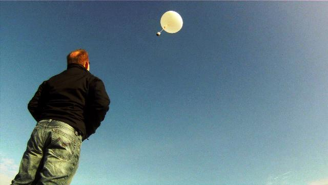 Troy Hale watches his project soar away.  The balloon reached an estimated altitude of between 60,000 and 80,000 feet.