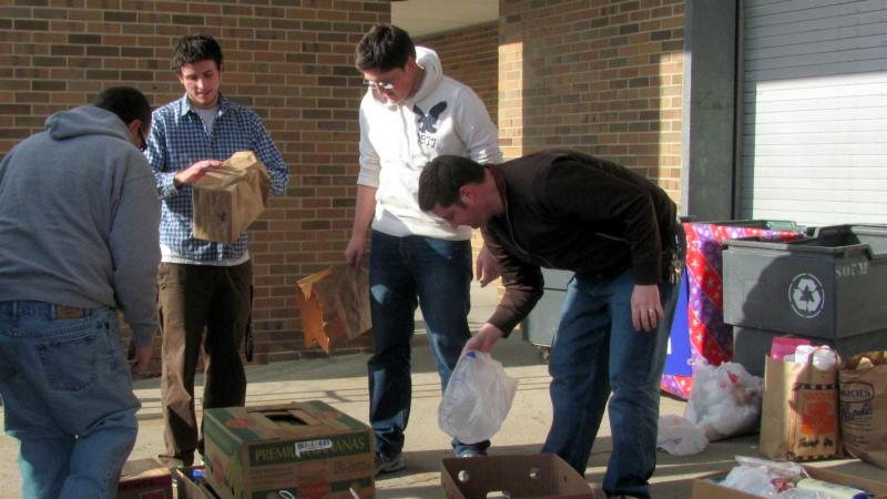 WKAR and Food Bank staff load the 2011 collection.
