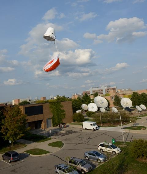 The payload glides above MSU before landing.