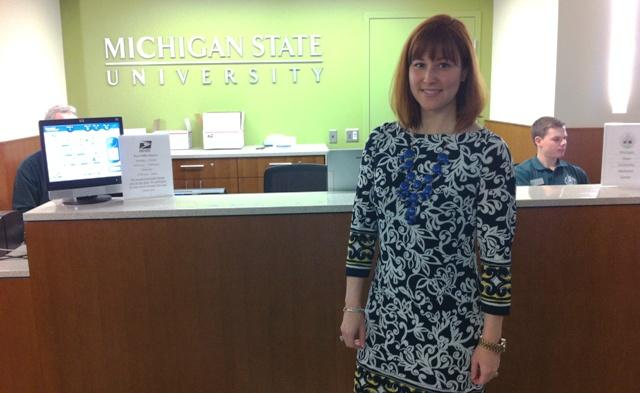 Kat Cooper, Communications Manager with Residential and Hospitality Services at MSU, at the Union's information desk.