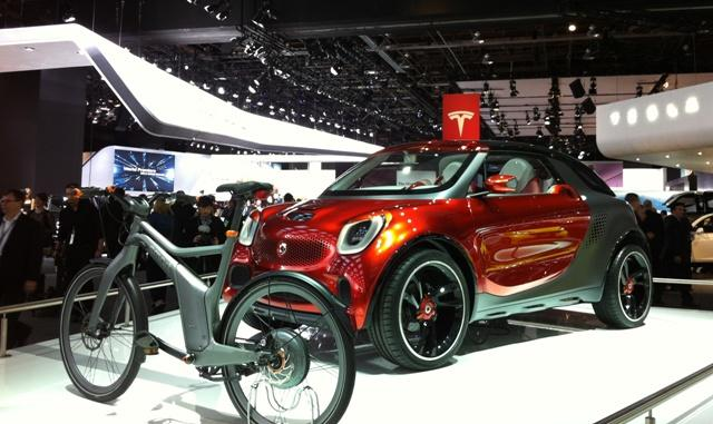Smart's Forstars concept includes a projector in the hood. Drive it up to a wall and show a movie drive-in style. They also have an electric bicycle on display.