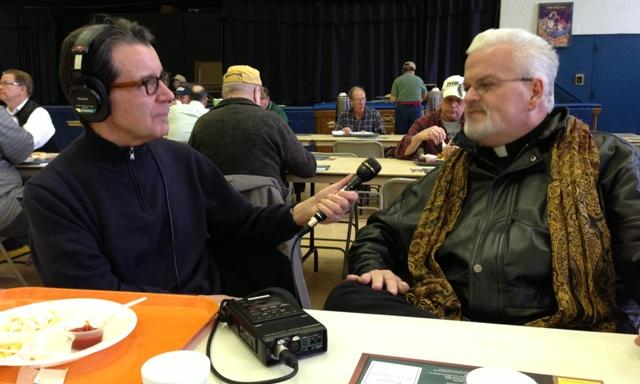 Fr. Bill Lugger talks with WKAR's Scott Pohl