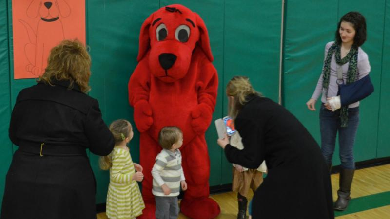The kids line up for a photo with Clifford