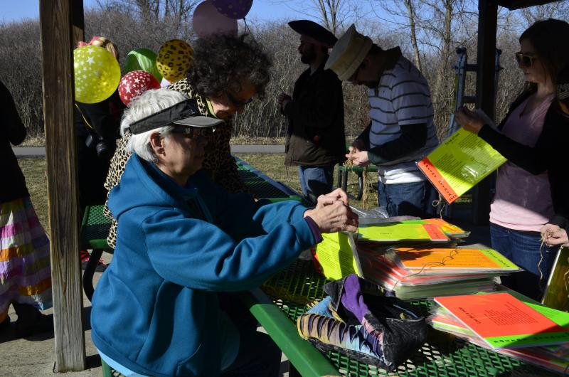 The East Lansing 'street arts commission' strings poems to hang on trees