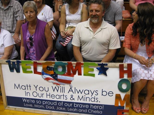 Hundreds of people filled Lumen Christi High School in Jackson Thursday to welcome home members of the 1461st Transportation Company.