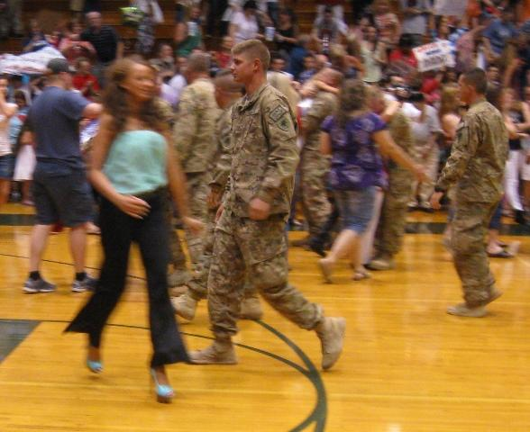 Anxious family members rush to meet their loved ones who've returned from duty in Afghanistan.