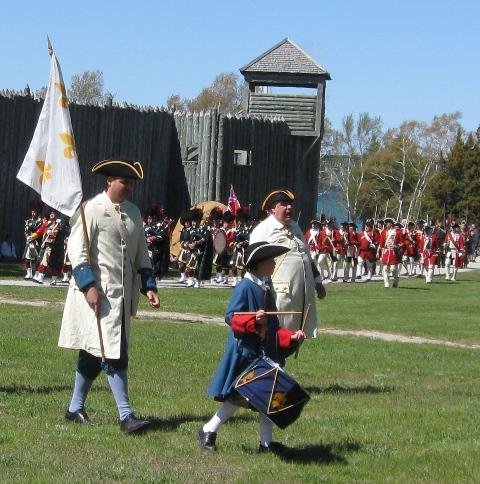 Actors portraying French soldiers play out the historic transfer of the fort from French to British control in September 1761.