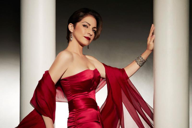 Estefan in red dress
