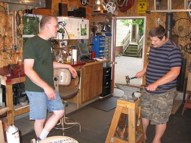 Tim Higgins (left) and Sam Pettersen are metalsmiths who've worked together for the past year through the Michigan Traditional Arts Apprenticeship Program