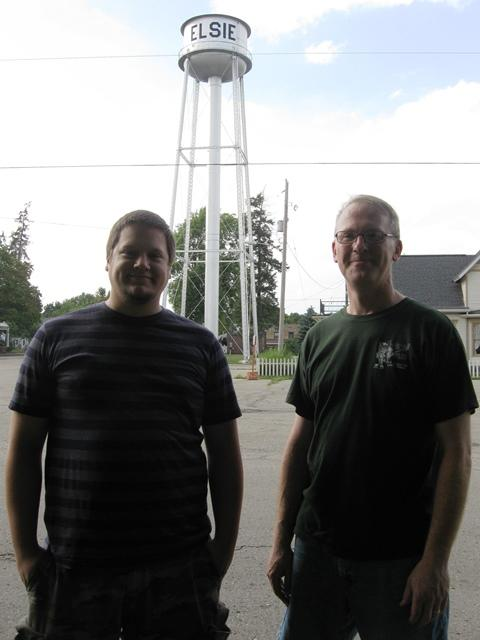 Sam Pettersen (left) and Tim Higgins outside Higgins' garage / workshop.  Incidentally, the two men did not build the large metal tower behind them.