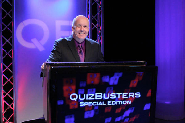 Matt Ottinger at QuizBusters podium