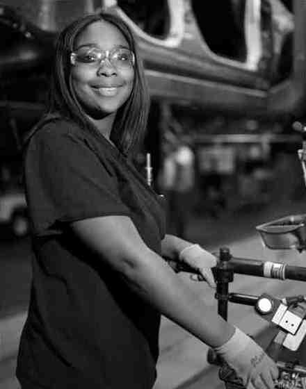 Monique Watson, who works at a GM plant building the Volt, is featured in 'Detroit Resurgent' at the MSU Museum.