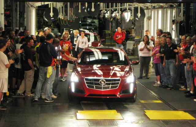 GM employees cheer the arrival of the millionth car made in their shop: a Cadillac CTS.