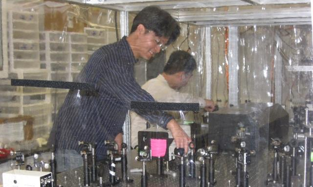 Kiseok Chang (left) and Zhen Sheng Tao are PhD. students working on MSU's new ultrafast microscope.
