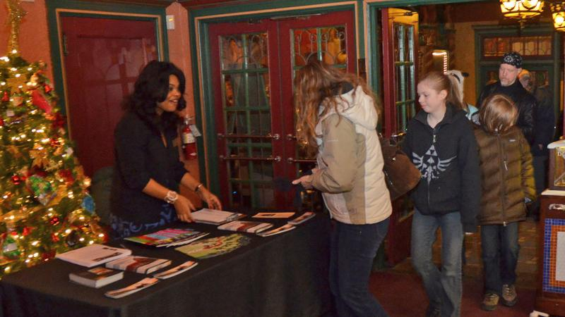 WKAR's ShaDonna Crosby greets guests at Michigan Theatre of Jackson