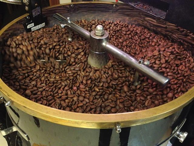 Coffee beans cooling after roasting.