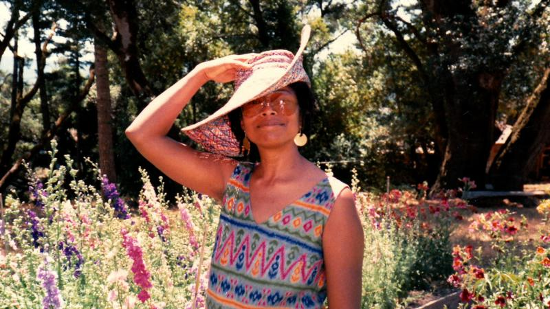 Alice Walker in garden wearing sun hat