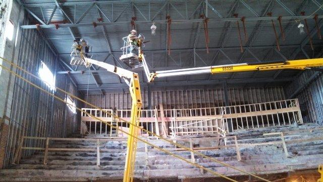 Crews worked on the balcony, tech booth and catwalks last July.