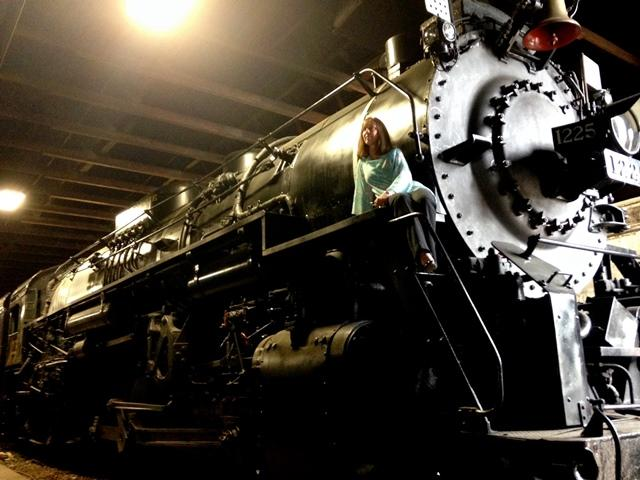 Train Expo coordinator Terry Bush climbs aboard the 1225 locomotive. Hollywood modeled 'The Polar Express' on the 1225.
