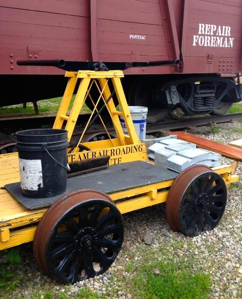 A handcar serves as a staging area for preparations.