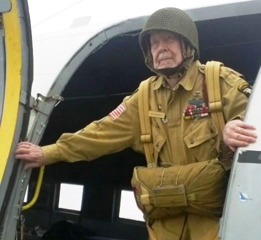 Paratrooper Donald Burgett air dropped into France on D-Day.  He was wounded three times during the Normandy campaign.  He still wears a piece of shrapnel around his neck.