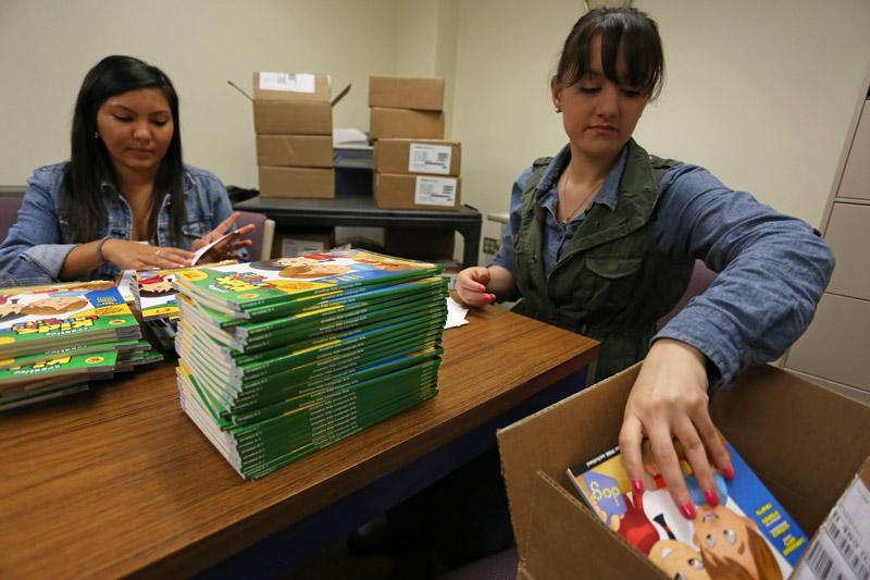 Two women packaging books