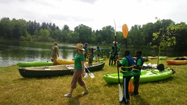 Children learn to kayak at Fidelity Lake, the heart of Ralph W. Crego Park. The facility re-opened Thursday after being closed since 1986.