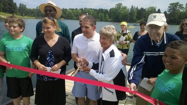 Members of the Crego family help mayor Virg Bernero cut the ribbon to mark the re-opening of Crego Park. The site underwent an extensive cleanup project funded by the state and city of Lansing.