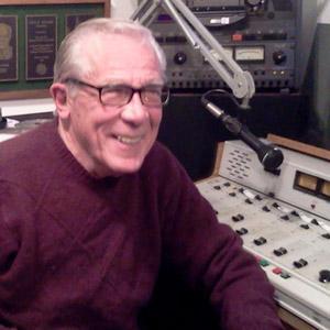 Man sitting at audio console