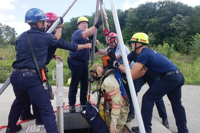 The mannequin is hoisted up.  In a real scenario, workers trapped below ground could fall victim to toxic gases that may render them unconscious.
