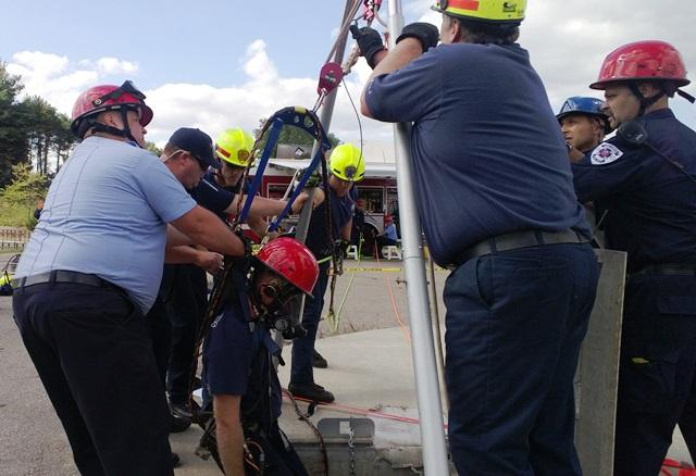 The first of two rescue workers is brought back up to the surface.