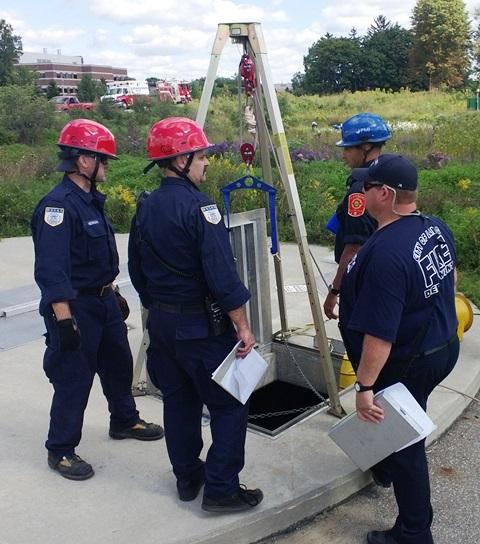 East Lansing Fire Captain Greg Baker (second from left) reviews the rescue procedures with his training team.