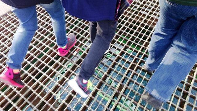 It's about a 200 foot drop from the iron grate at the center of the Mackinac Bridge to the waves below.