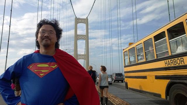 B. J. Warga of Petoskey walked the bridge as Superman.  There were no reported eyewitness accounts of him flying over the Mackinac Bridge to the finish line.