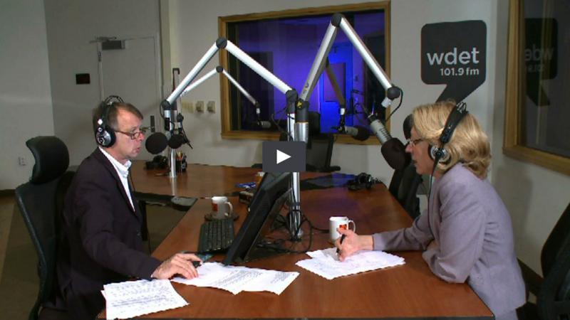 Pluta and Land at microphones in radio studio