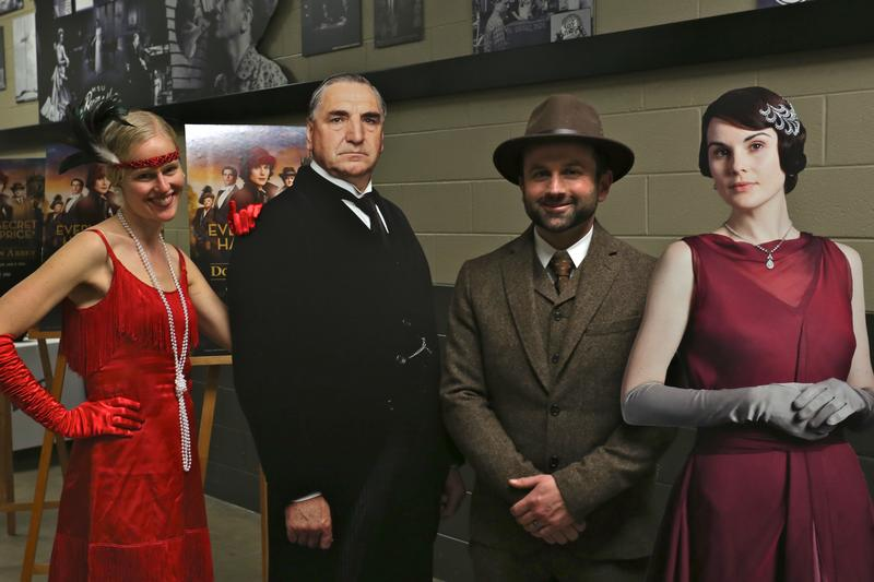 guests in period constume posing with cardboard cutouts
