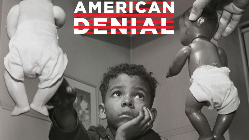 American Denial title over photograph of boy choosing between two dolls