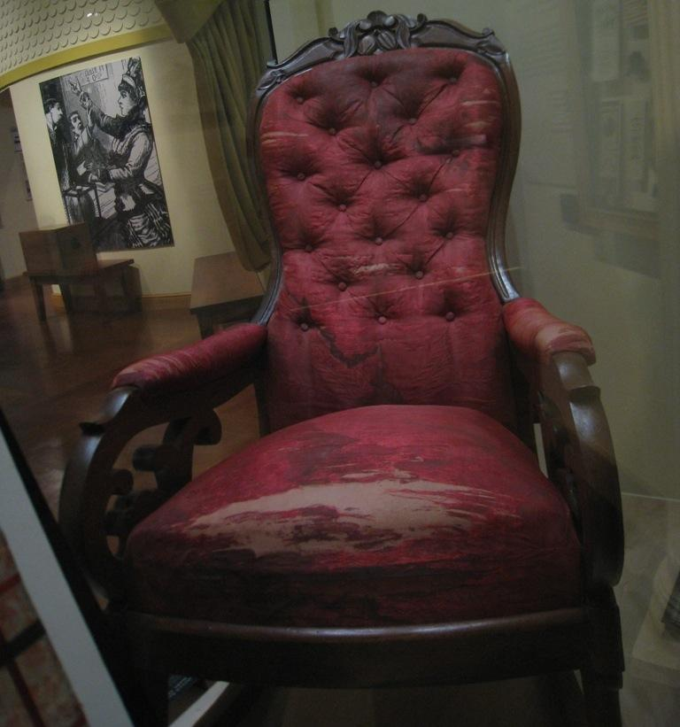 Red theatre chair in display booth