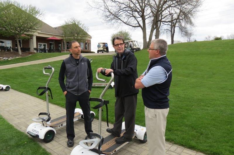 Justin McNeil of Golfboard (L) and John Kuenzli (R) with WKAR's Scott Pohl.