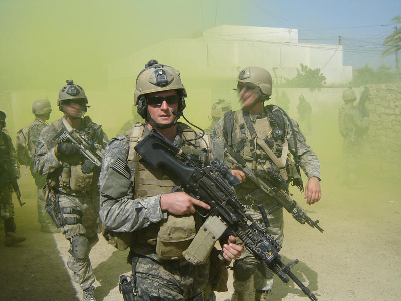 Master-At-Arms 2nd Class (SEAL) Michael A. Monsoor, left, participates in a patrol in support of Operation Iraqi Freedom.