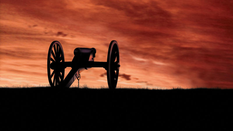 cannon on a hilltop set against a dark red sky