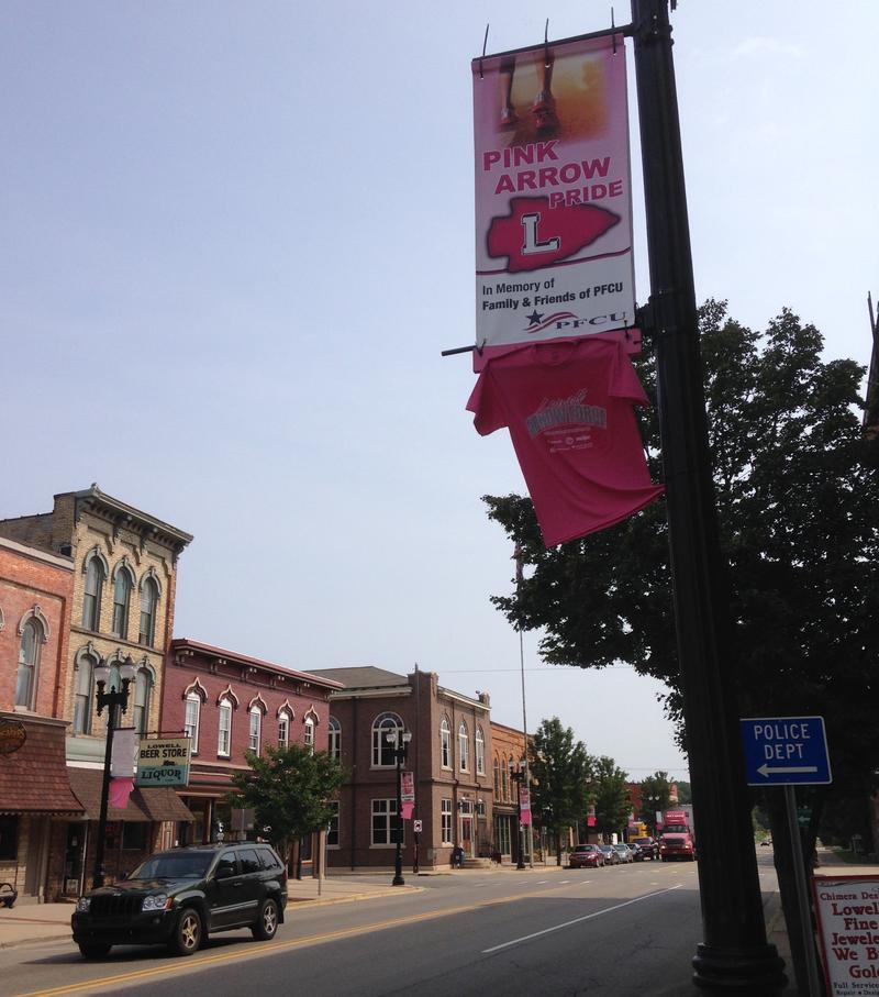 pink arrow pride banner in Lowell