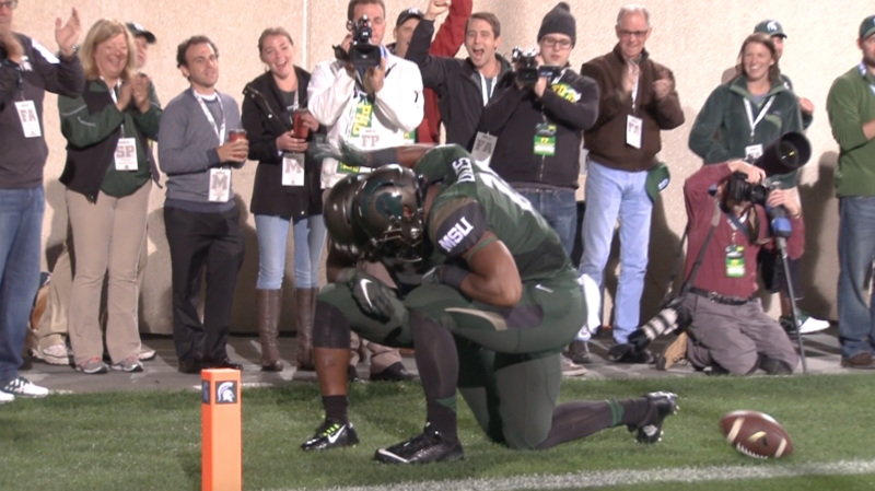 LJ Scott takes a knee after running for a TD.