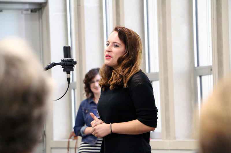 young woman at microphone
