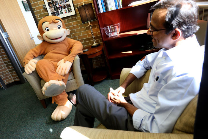 Curious George meets with Prabu David