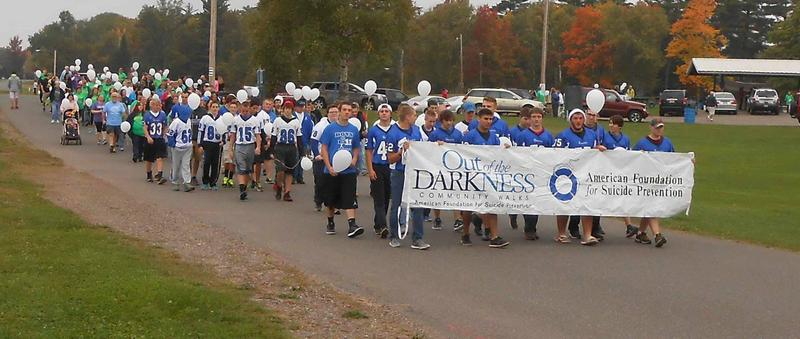Ishpeming HS football team in parade