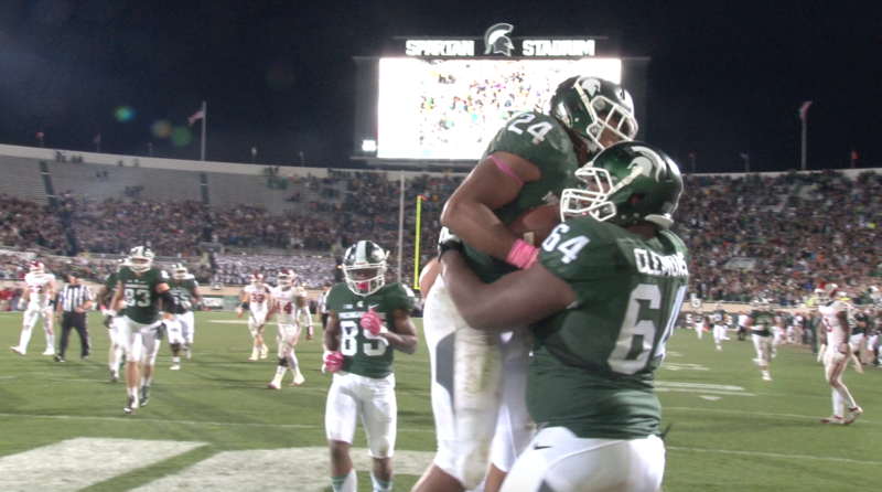 MSU RB Gerald Holmes celebrates after scoring a TD in the fourth quarter against Indiana.