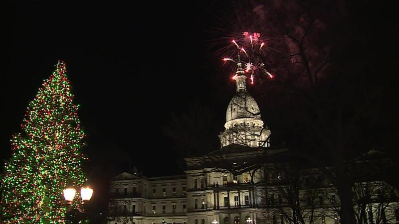 Fireworks over the state capitol dome and christmas tree