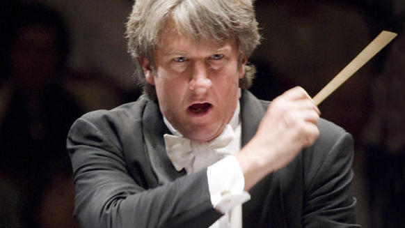 Muffitt conducting orchestra