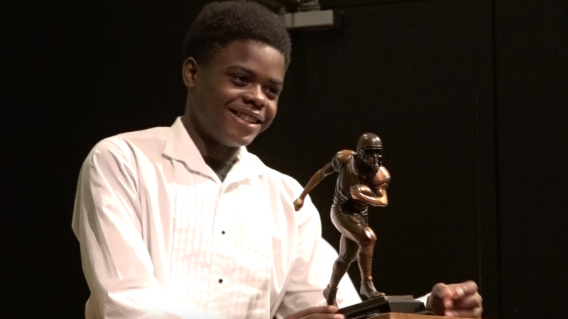 Carre'on Gordon smiles at the podium after receiving the 2015 LFL Player of the Year Award.